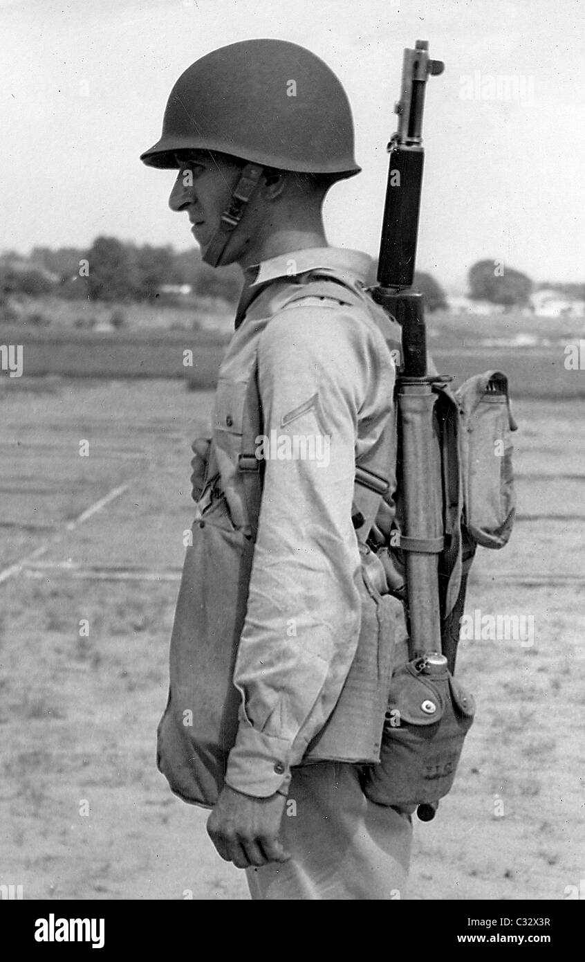 An American soldier models the newly introduced M1 combat helmet. WW11. - Stock Image