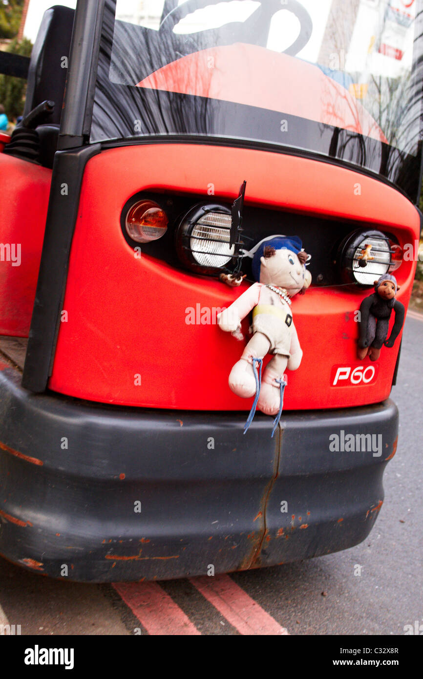 Child's toy stuck to the front of an electric vehicle used at St George's Hospital. Tooting, London Stock Photo