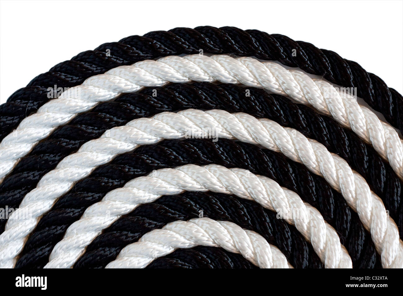 Black and white rope on white background - Stock Image