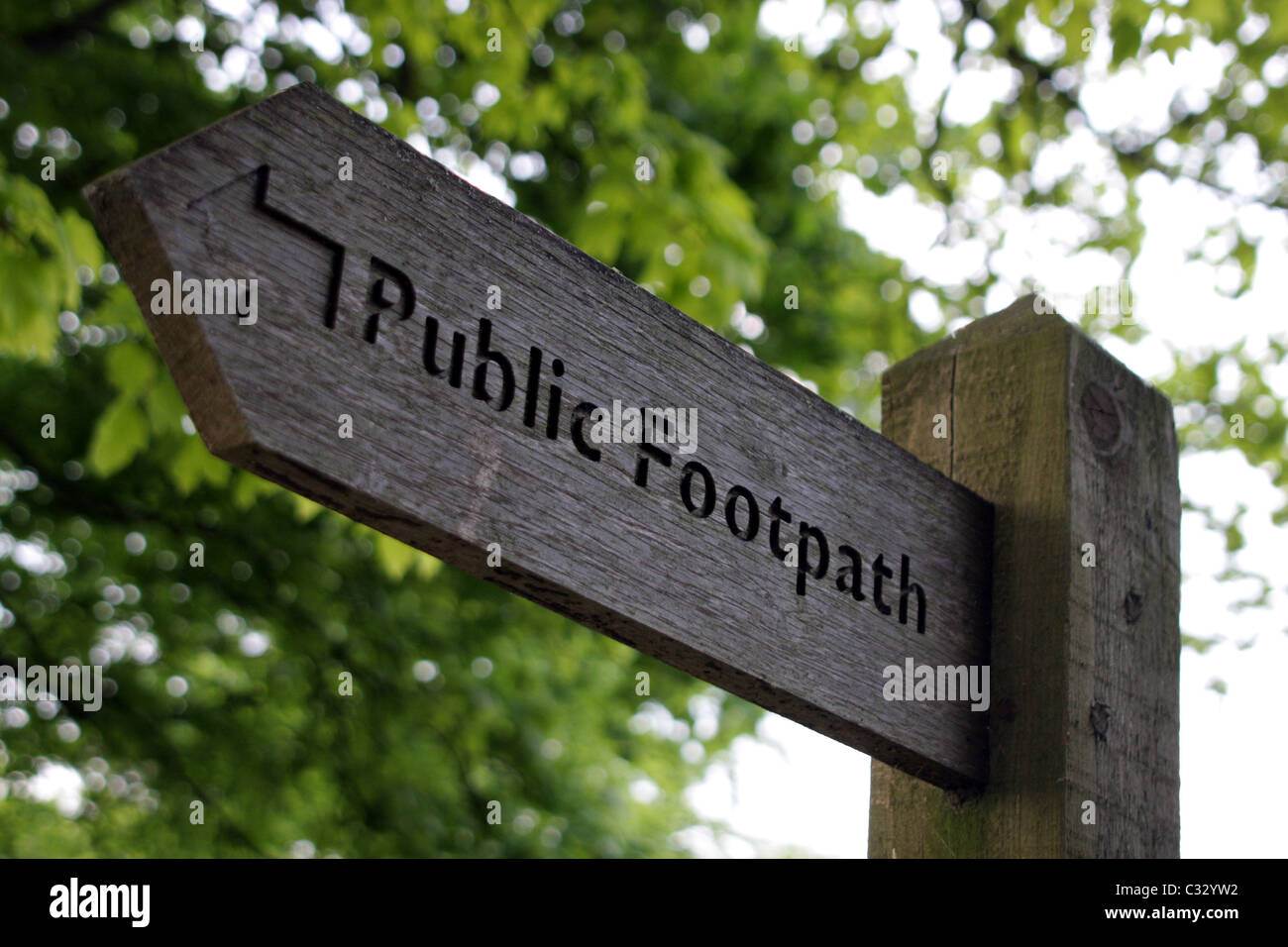 wooden public footpath sign - Stock Image