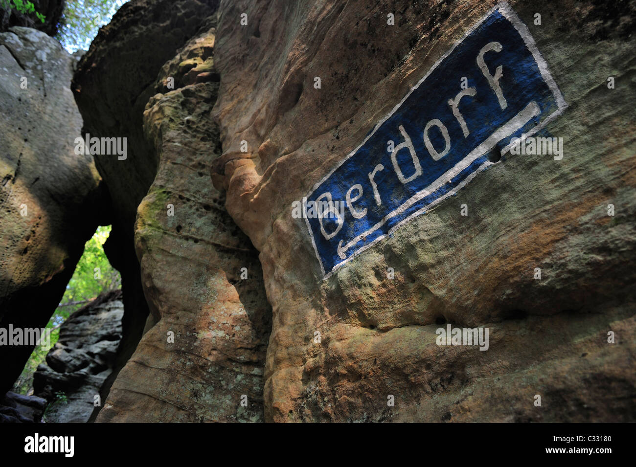Berdorf sign on sandstone rock at Wanterbaach in Berdorf, Little Switzerland / Mullerthal, Grand Duchy of Luxembourg - Stock Image
