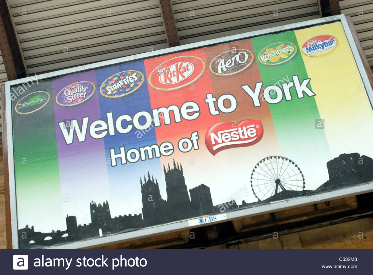 York UK Sign at the train station saying Welcome to York, Home of Nestle, this being so after Nestle took over local - Stock Image
