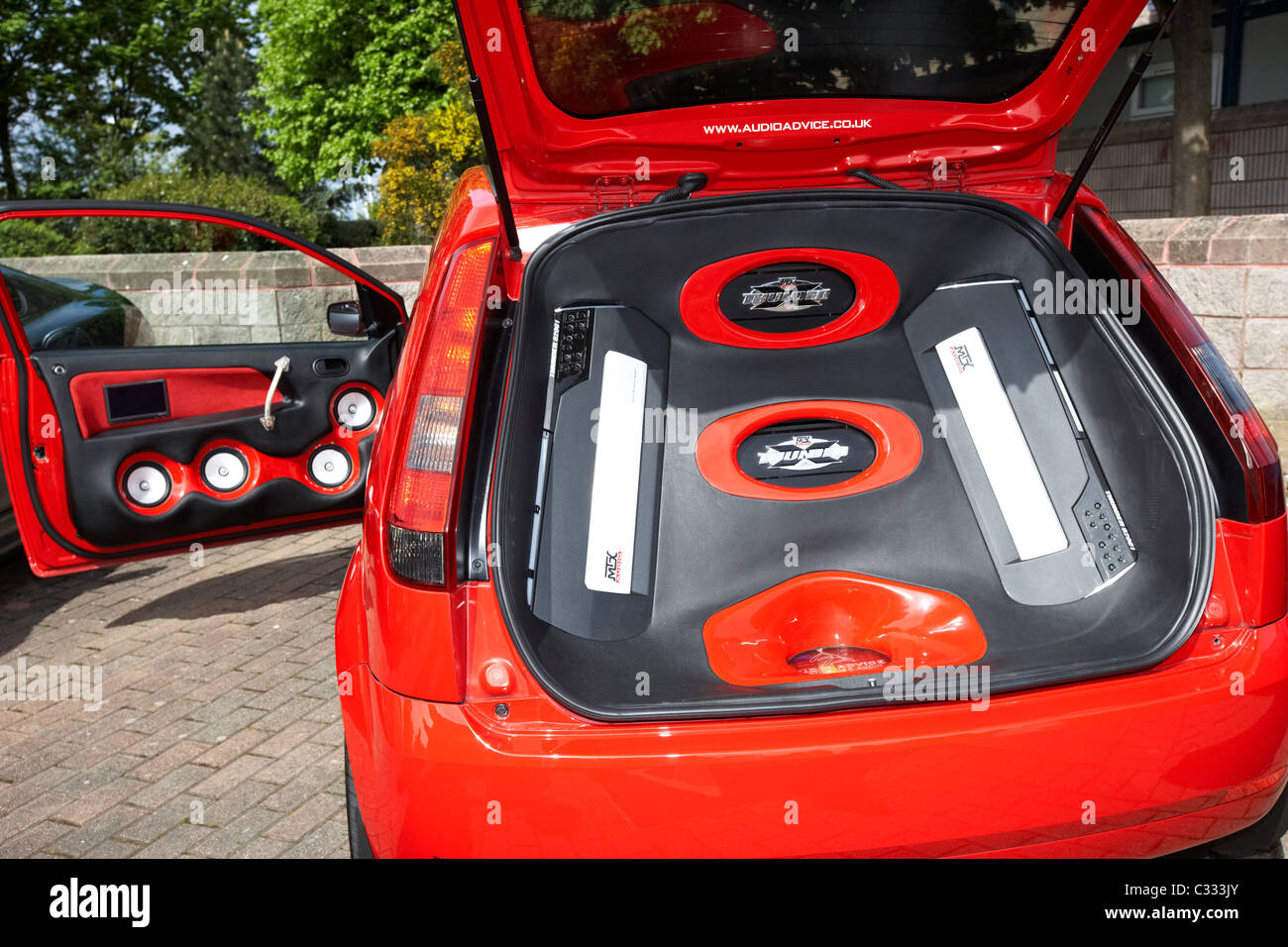 loud sound system filling the back of a ford focus at a