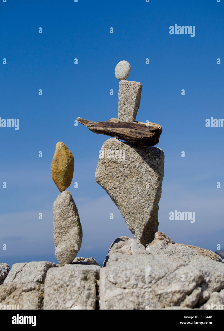 Rock balancing - finely balanced and creative stone stacking - Stock Image