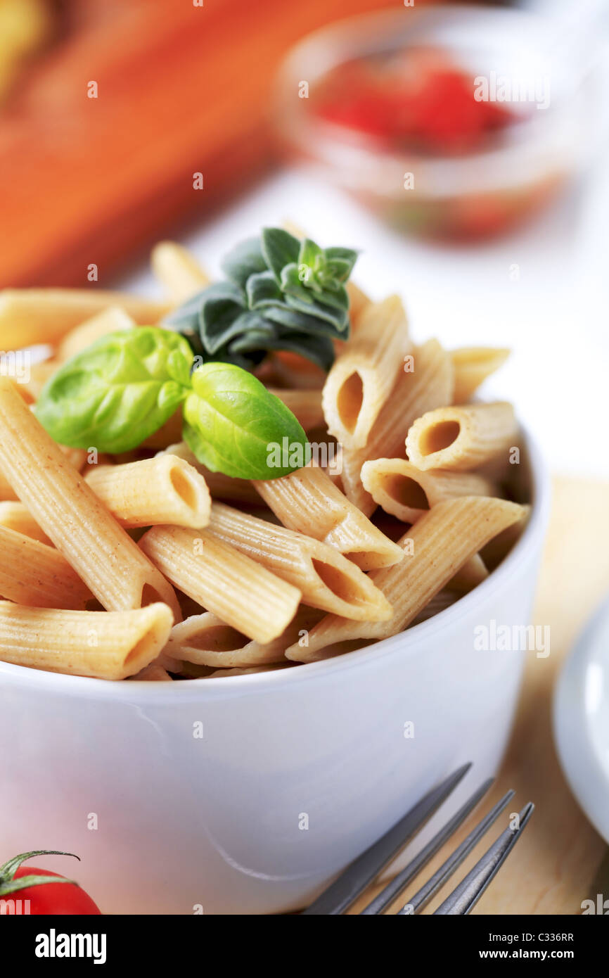 Bowl of whole wheat pasta - detail - Stock Image