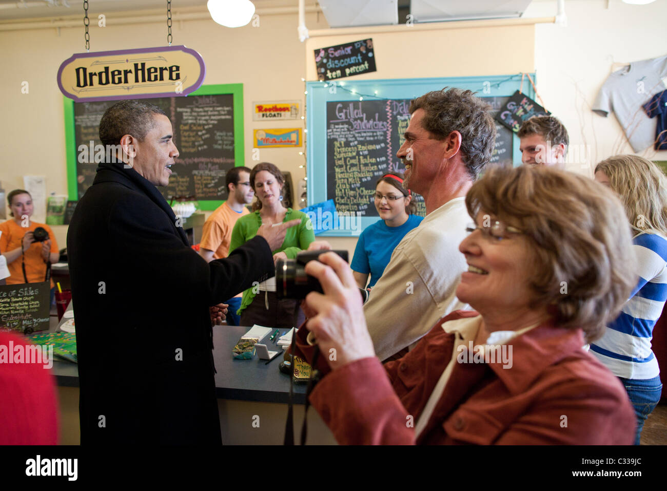 President Barack Obama greets patrons and employees during a stop at Donckers in Marquette, Mich., Feb. 10, 2011. - Stock Image
