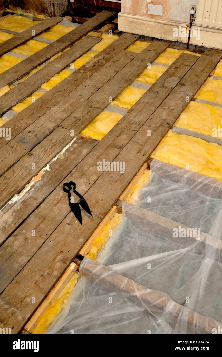Installation Of Fibreglass Insulation Under Floorboards In