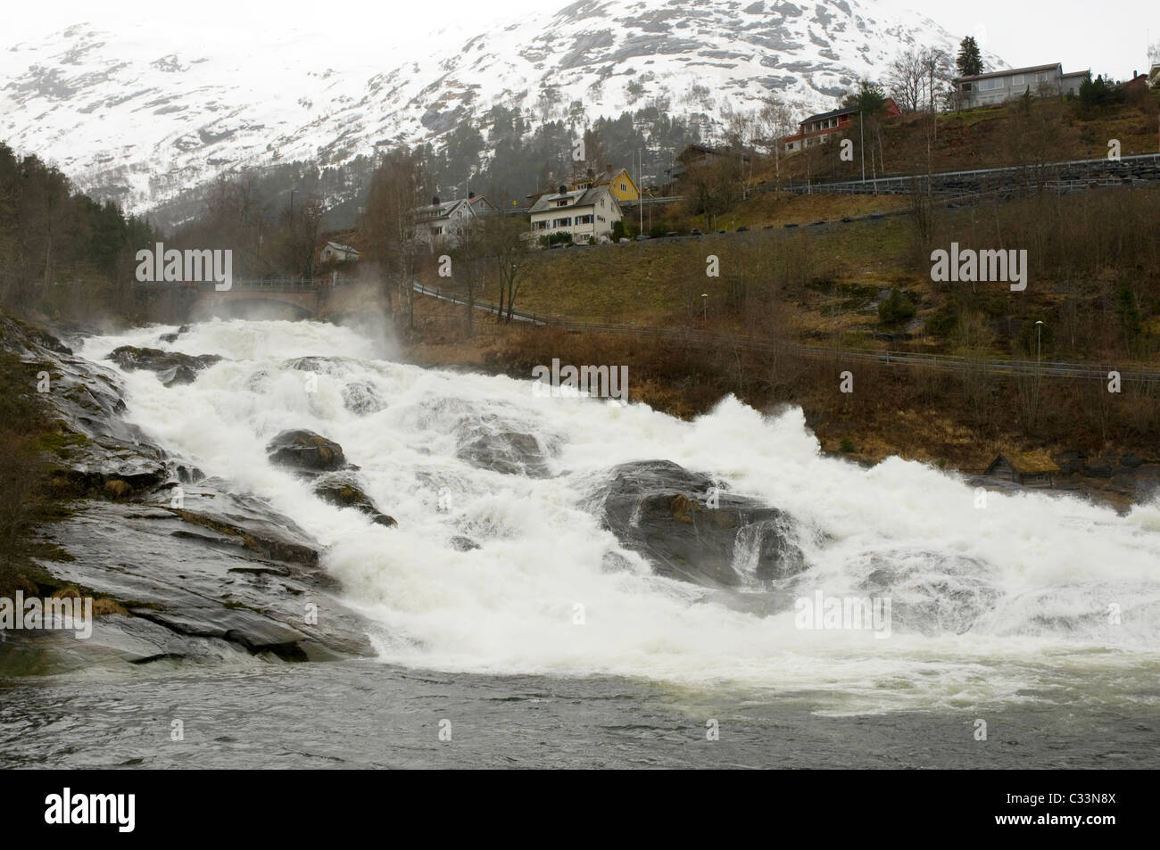 meltwater cascading through the waterfall at Hellesylt on the Geiranger fjord, Norway - Stock Image
