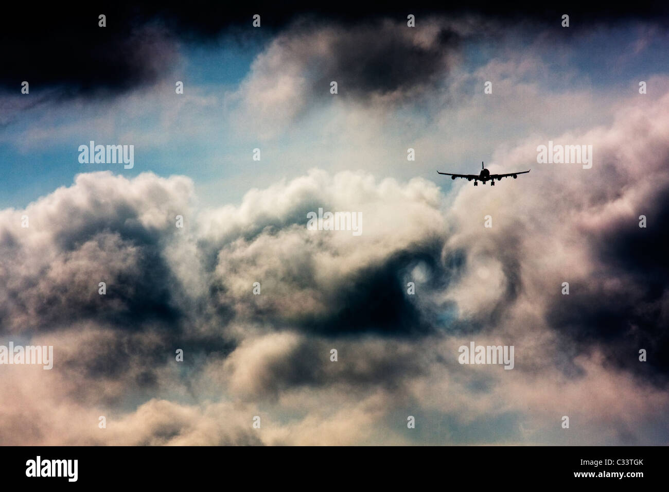 Wake turbulence forms behind commercial airliner. - Stock Image