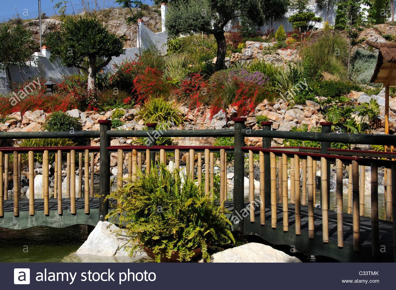 Oriental Garden Wooden Bridge Stock Photos & Oriental Garden Wooden ...