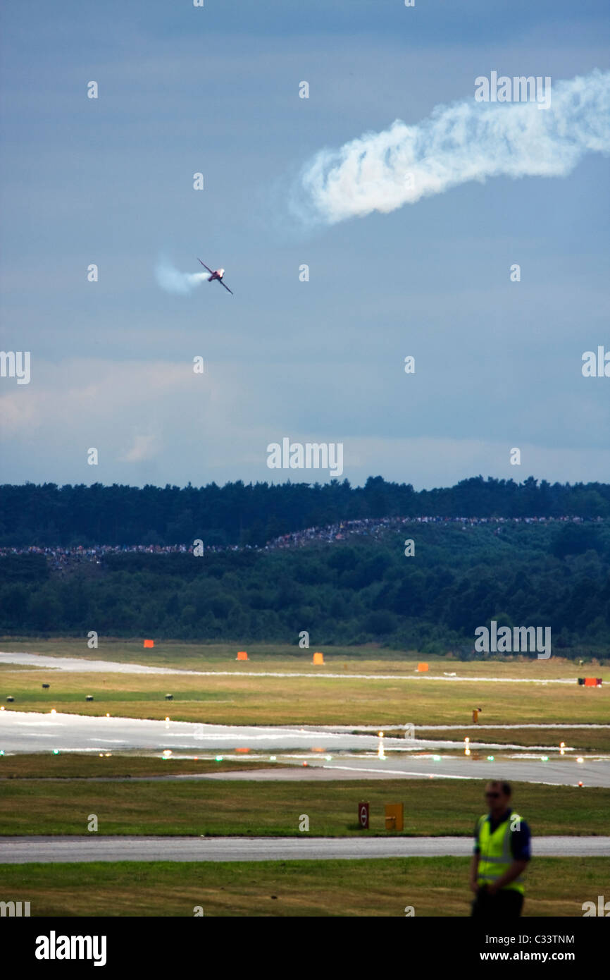 UK Air Force Red Arrows display team British Aerospace Hawk T1 thrills crowds at Farnborough International Airshow - Stock Image