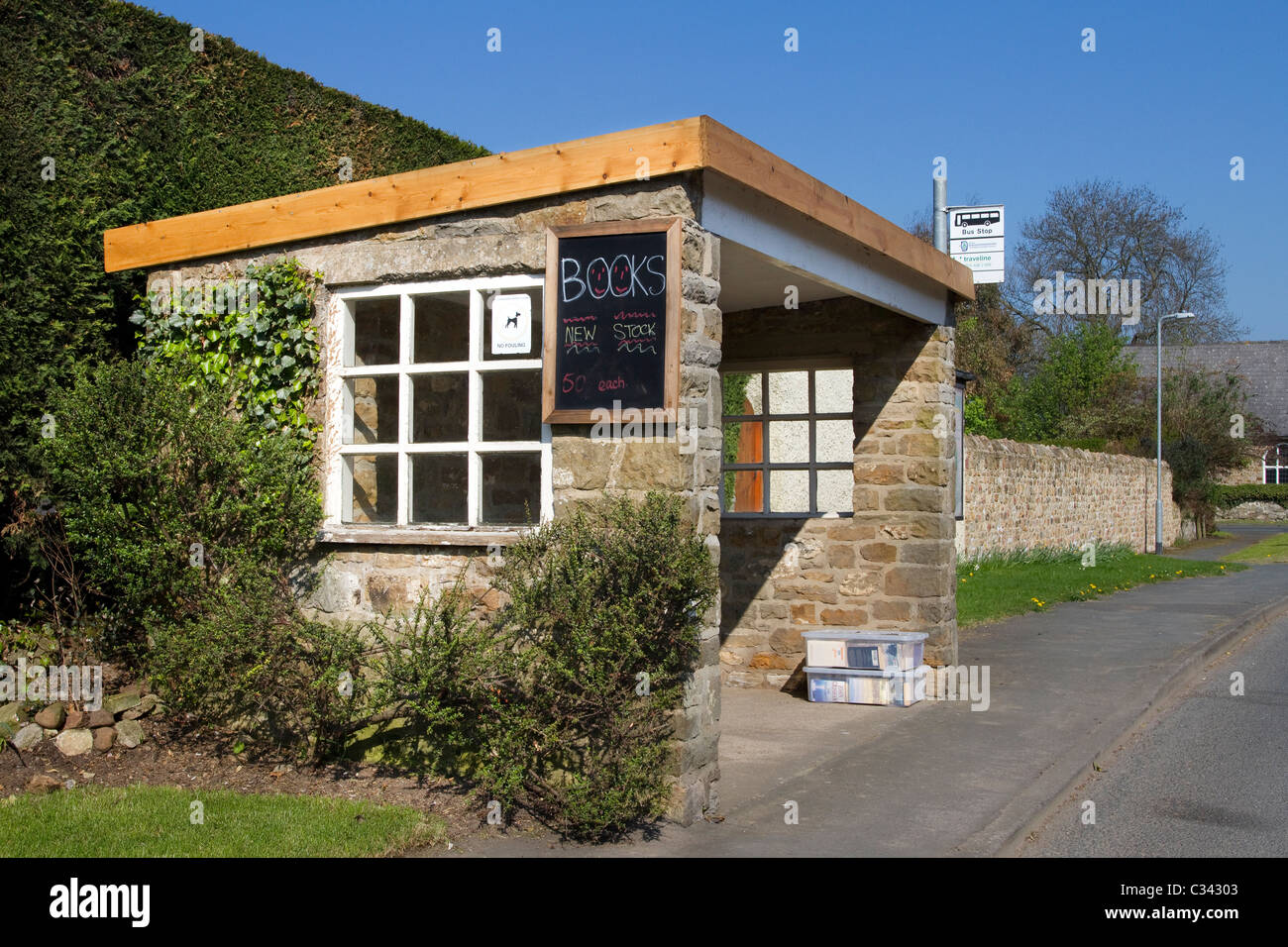 Bus shelters, bus stop, waiting shelters, Community Book Exchange _Books for Sale_Moulton, Yorkshire, UK - Stock Image