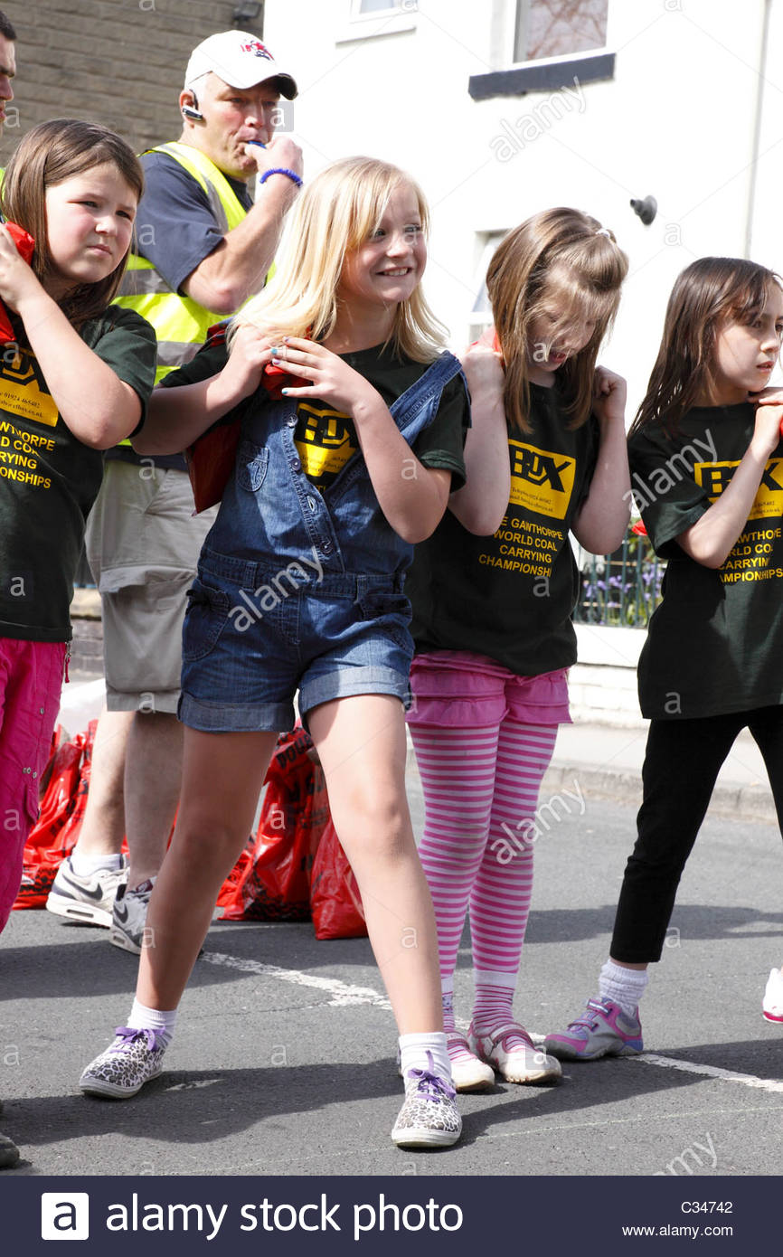 Girls lining up for the start of their Coal Race . Gawthorpe Coal Race near Ossett West Yorkshire England Easter Stock Photo