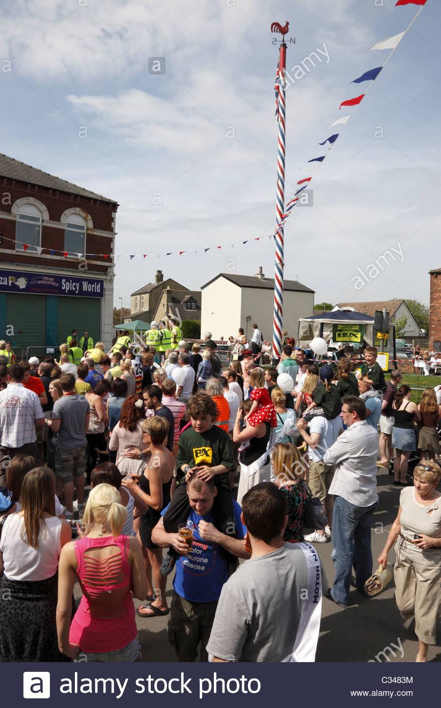 Gawthorpe village centre and Maypole . Easter Monday The World Coal Carrying Championships Gawthorpe West Yorkshire Stock Photo