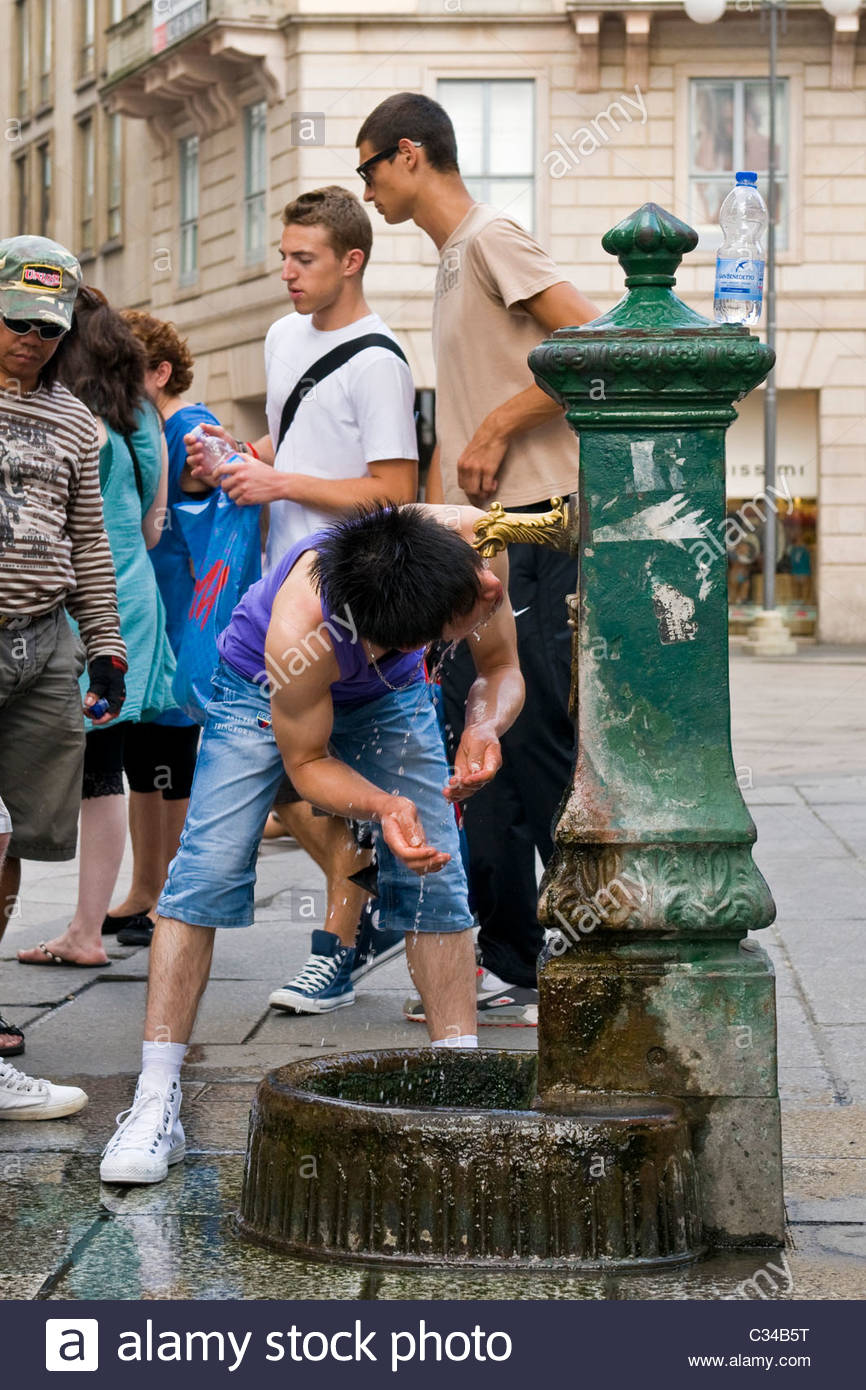 Cool in a fountain near Duomo square, Milan, Italy - Stock Image