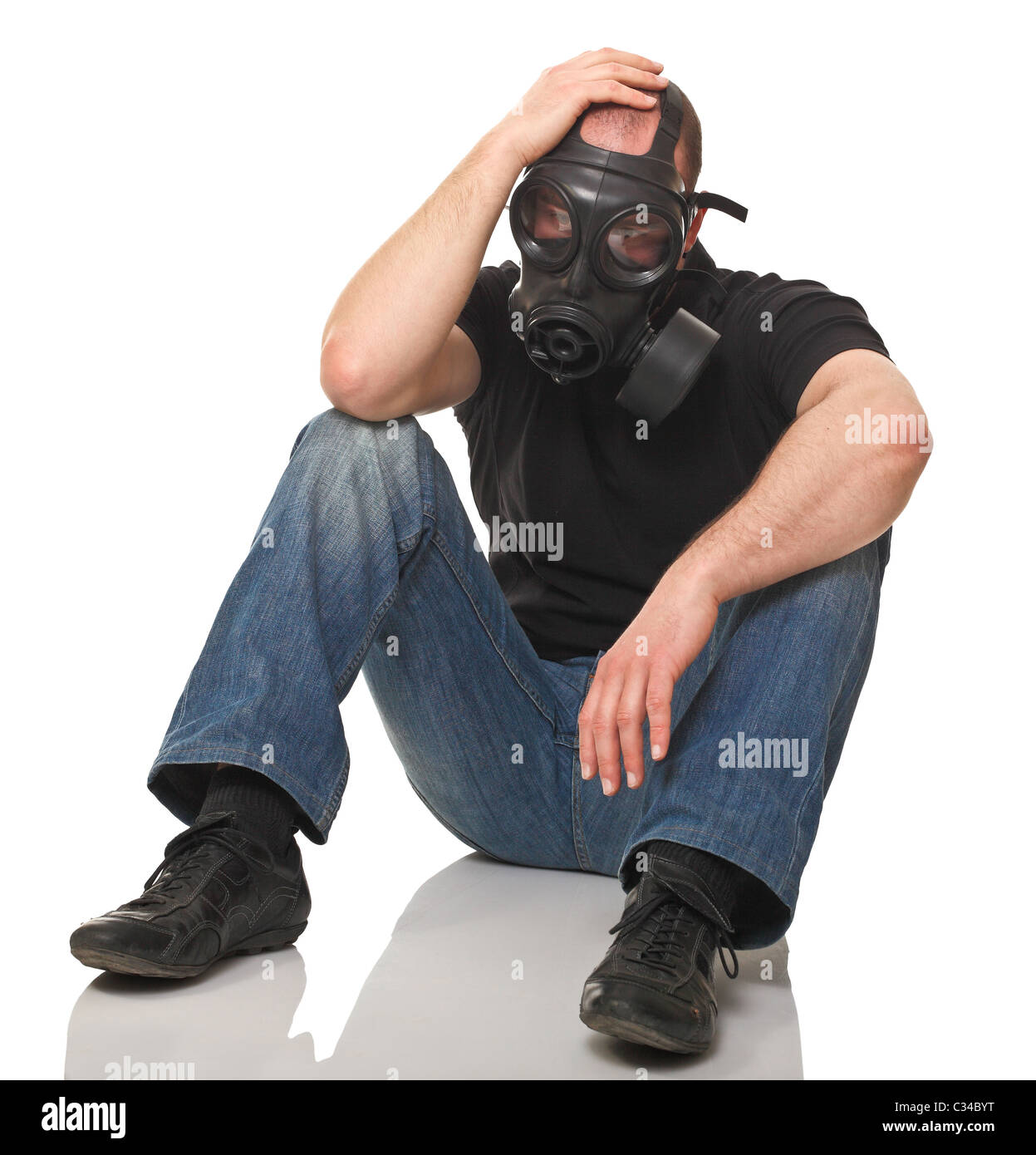 sit man wearing gas mask isolated on white - Stock Image