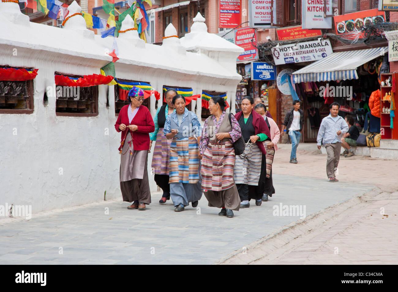 Tibetans at Bouddhanath Stupa - Stock Image