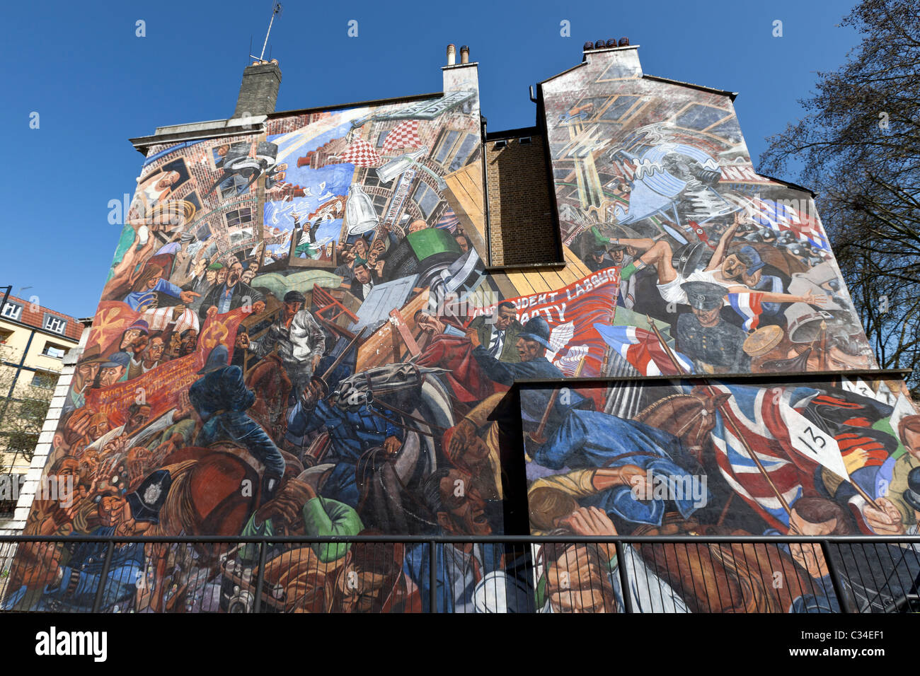 The Battle of Cable Street Mural created by artist Dave Binnington, London, England, UK. - Stock Image