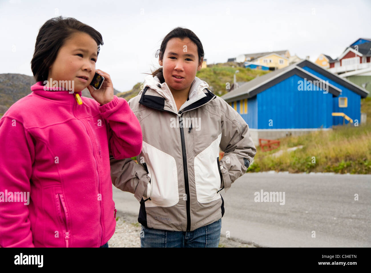 Girl talking on a mobile phone. Qaqortoq (Julianehåb), South Greenland - Stock Image
