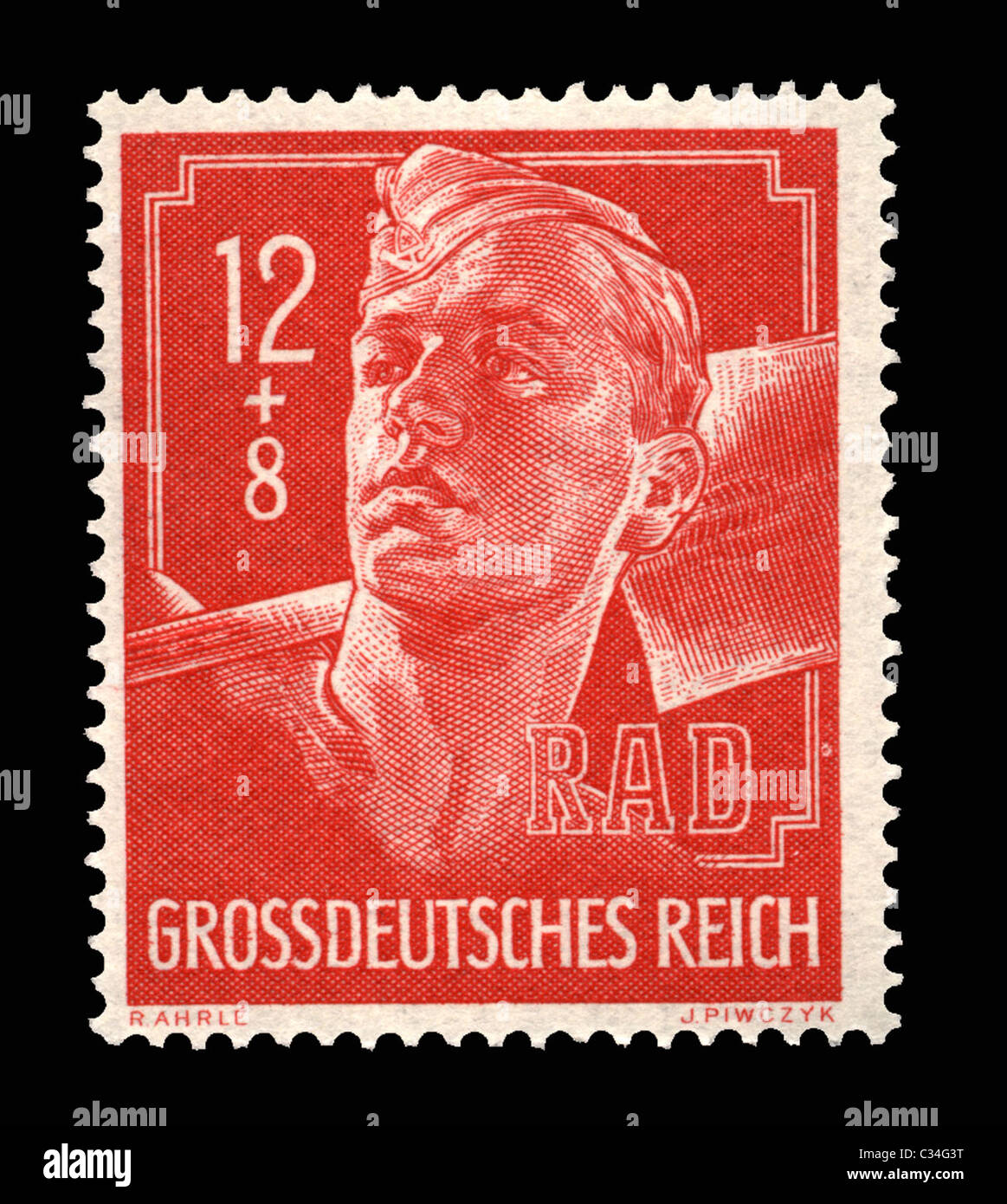 A WW11 German postage stamp showing an RAD labor worker with shovel - Stock Image