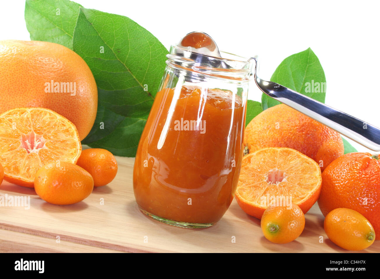 Orange marmalade with different Citrus fruits on a wooden board - Stock Image