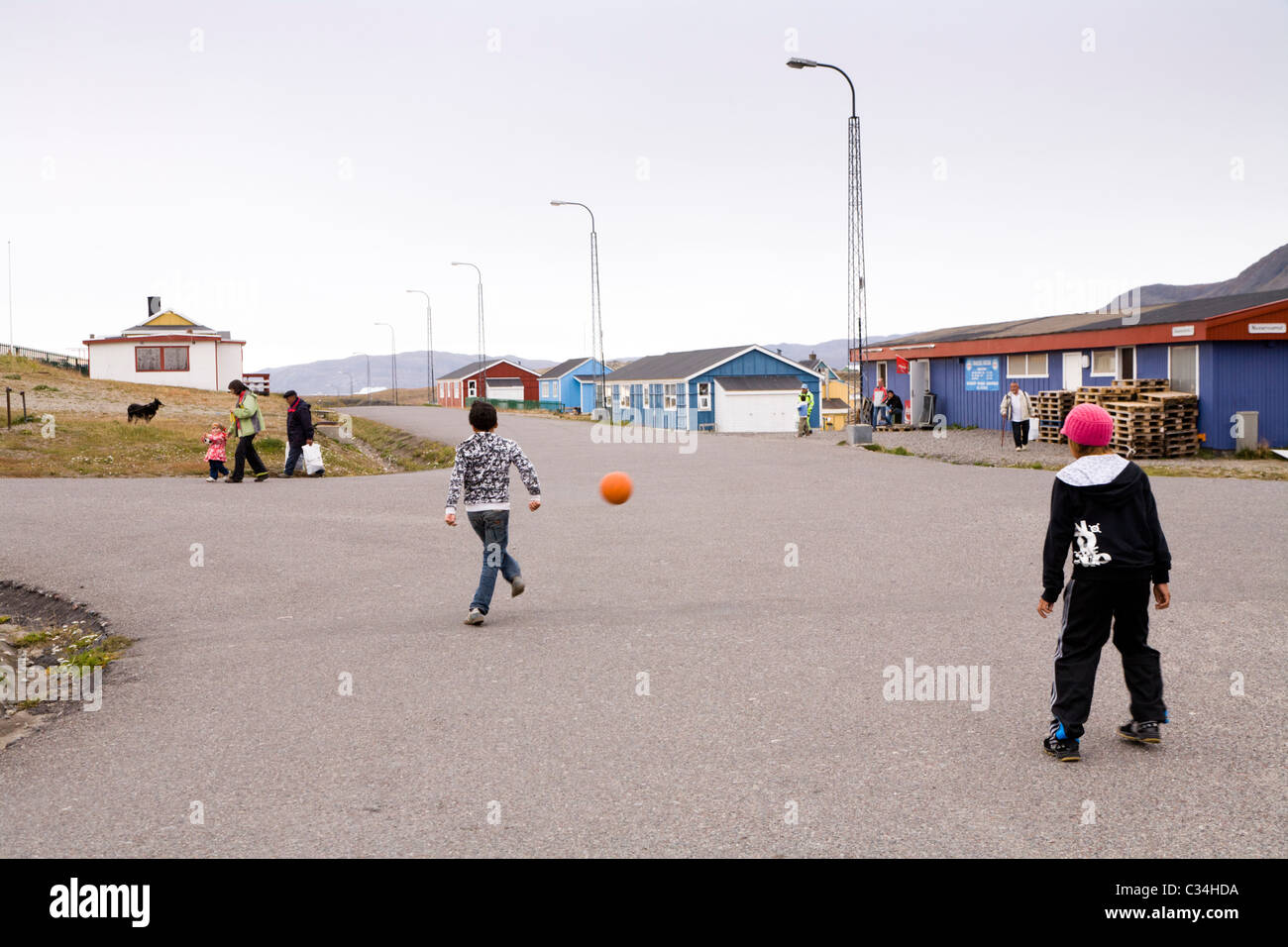 Boys playing soccer, Narsaq, South Greenland Stock Photo
