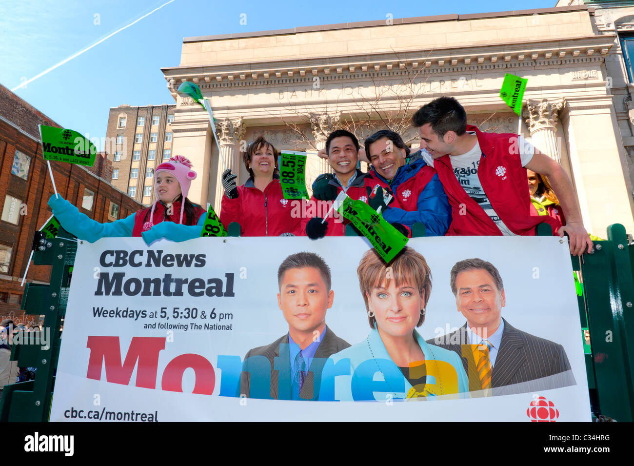 CBC TV personalities aboard a float participating to the St-Patrick's Day parade in Montreal. - Stock Image