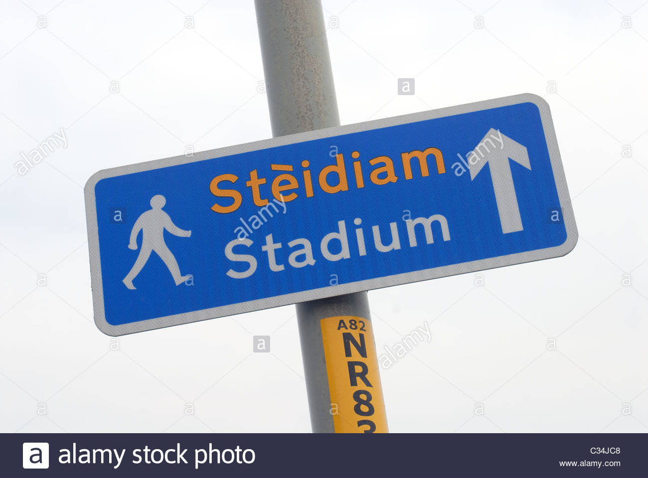 Inverness Scotland Bi-lingual Pedestrian Sign for the Stadium. - Stock Image