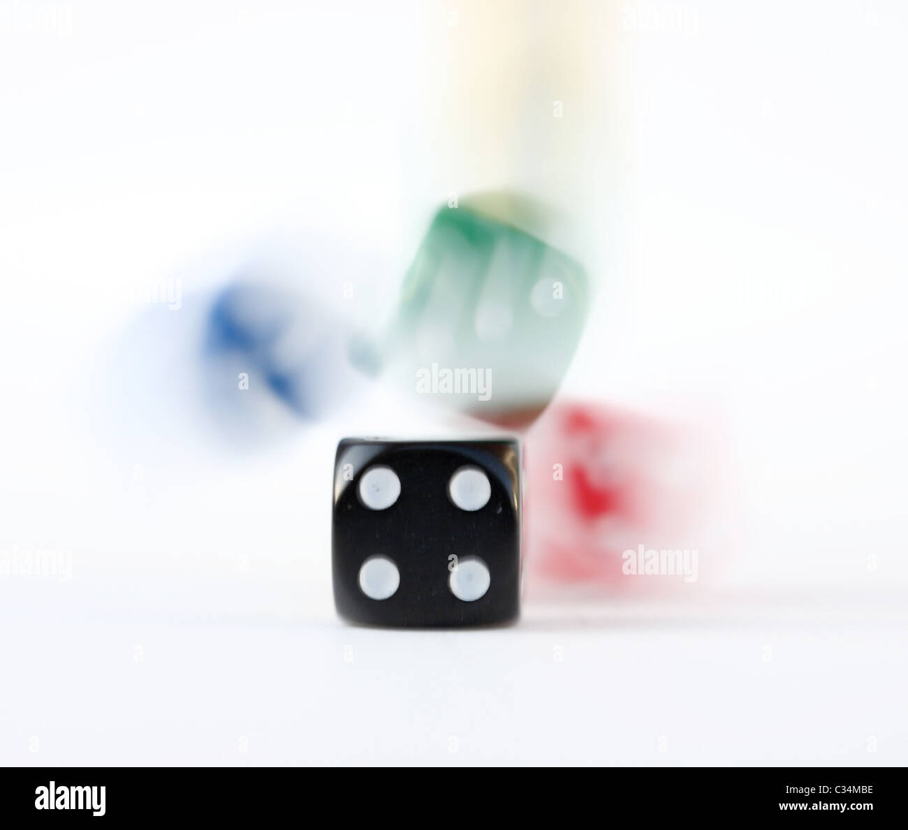 Multi colored dice rolling - Stock Image