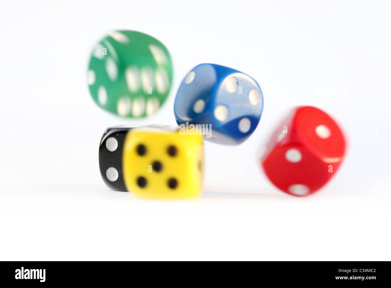 Multi colored dice rolling - Stock Image