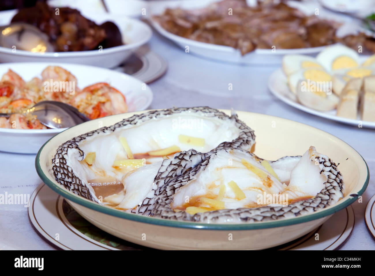 Home Cooked Steamed Sea Bass Fish with Ginger and Soy Sauce - Stock Image