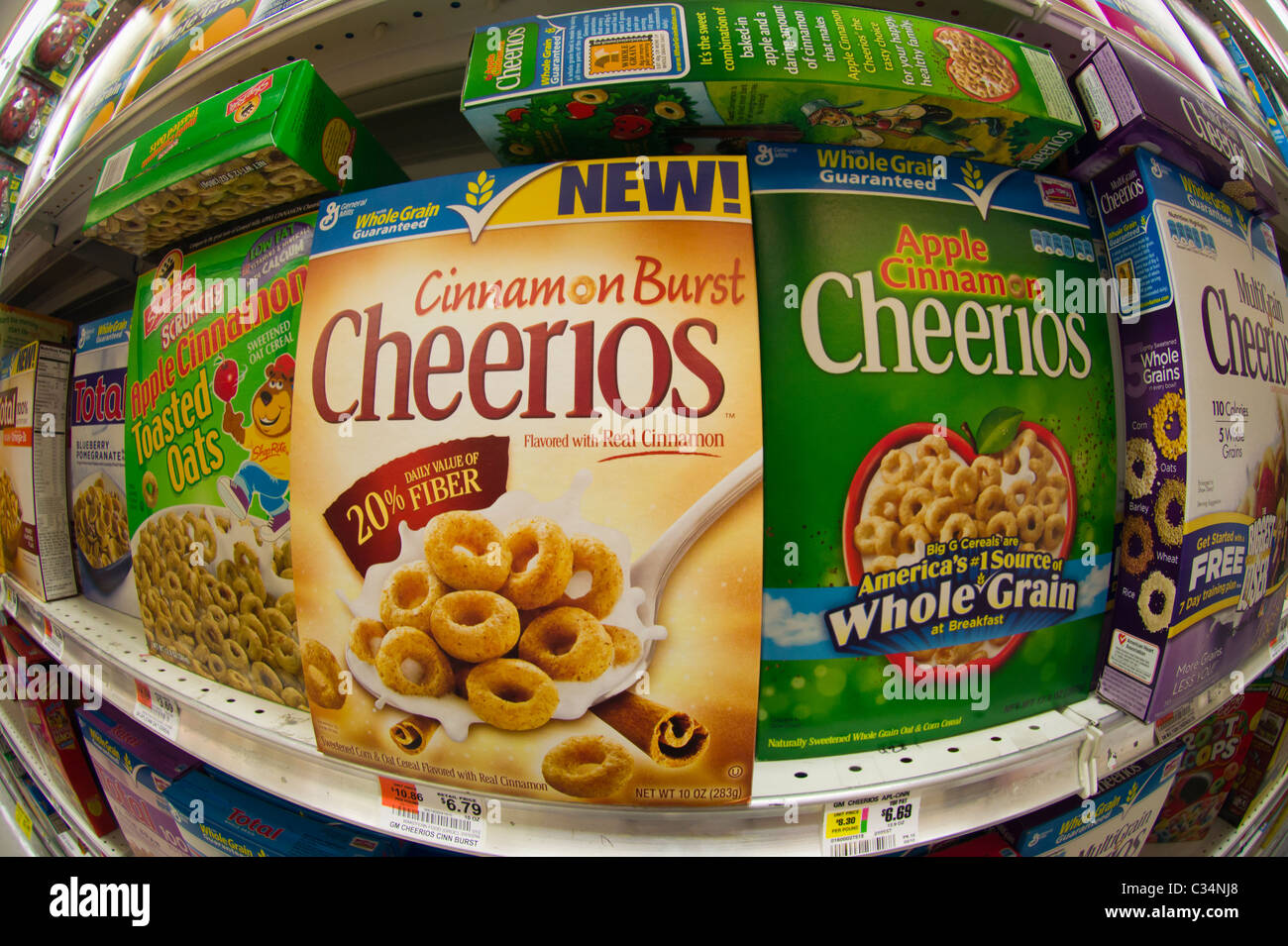 Boxes of General Mills Cheerios breakfast cereals in the grocery department of a store in New York - Stock Image