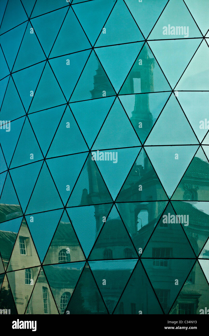 A fractured image of Leeds Civic Centre reflected in the Leeds Rosebowl glazing - Stock Image