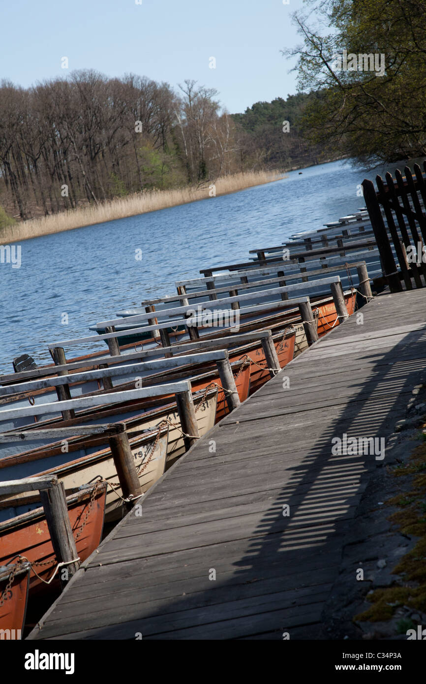 Boats in a row by the lake on a spring day - Stock Image