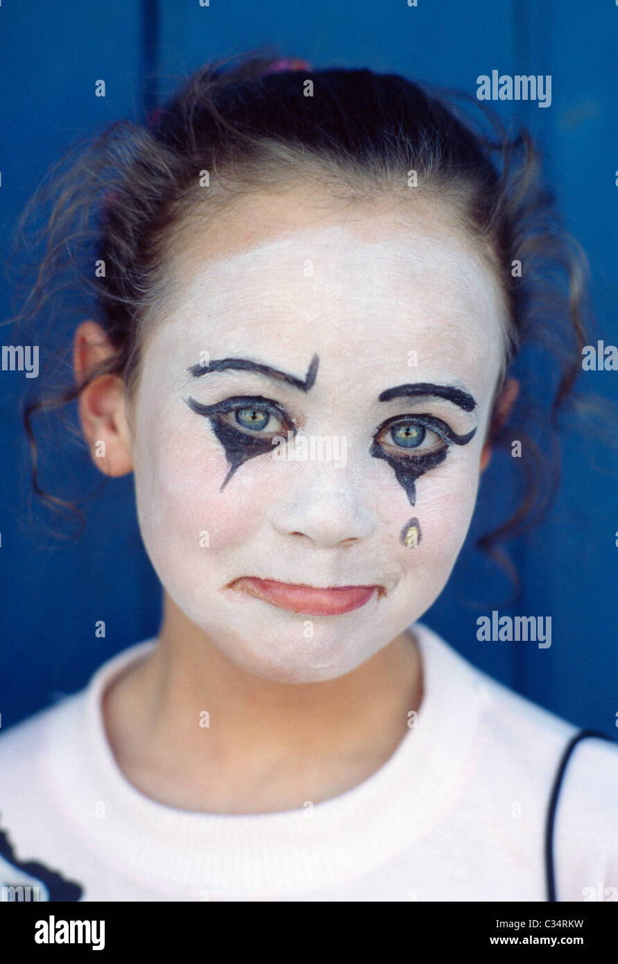 Portrait Of A Young Girl Wearing Sad Clown Makeup - Stock Image