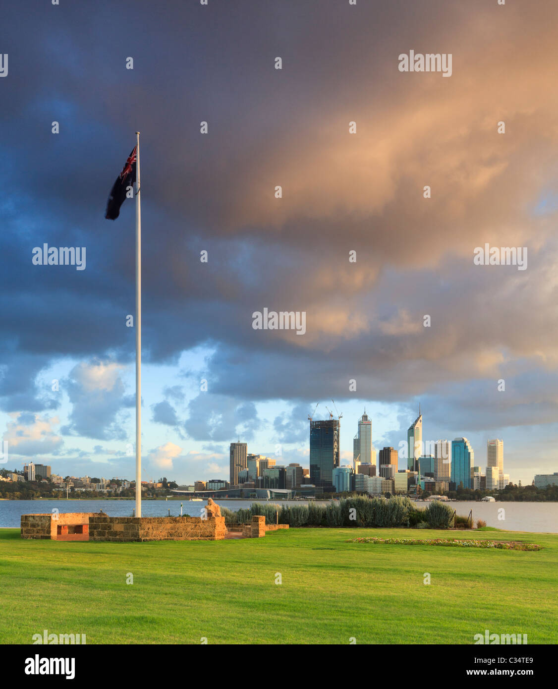 Australian Flag in Sir James Mitchell Park, South Perth flying over Perth city at sunrise. - Stock Image