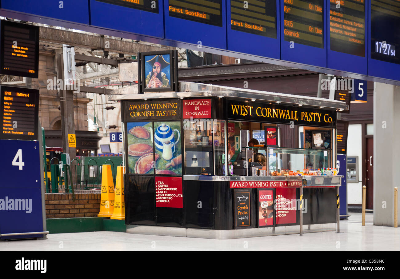 West Cornwall Pasty Company snack booth in Glasgow Central Station concourse, under the departures board. - Stock Image