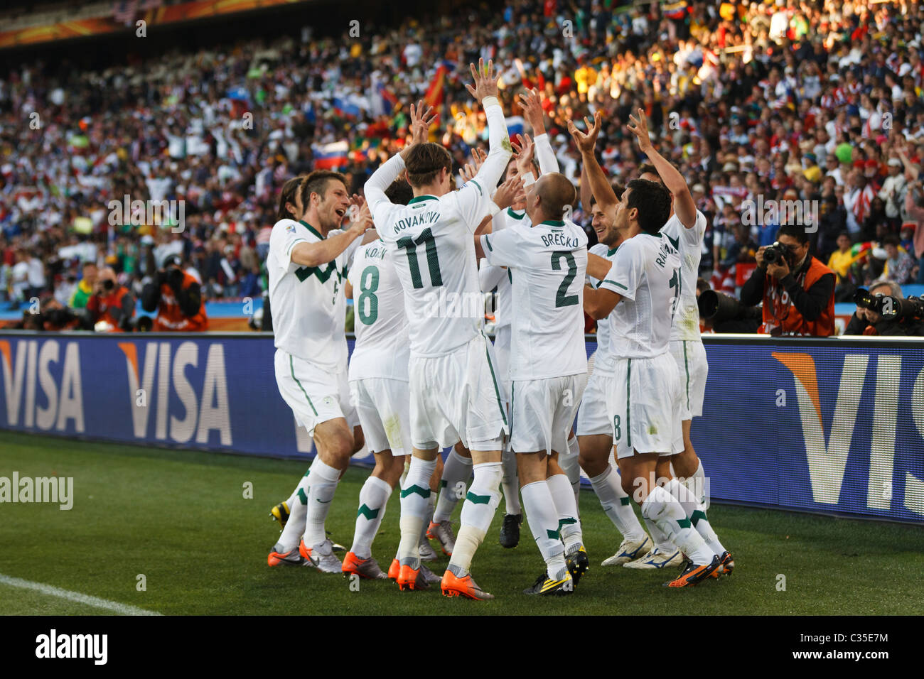 Slovenian players celebrate after scoring a goal against the United States during a 2010 FIFA World Cup football - Stock Image