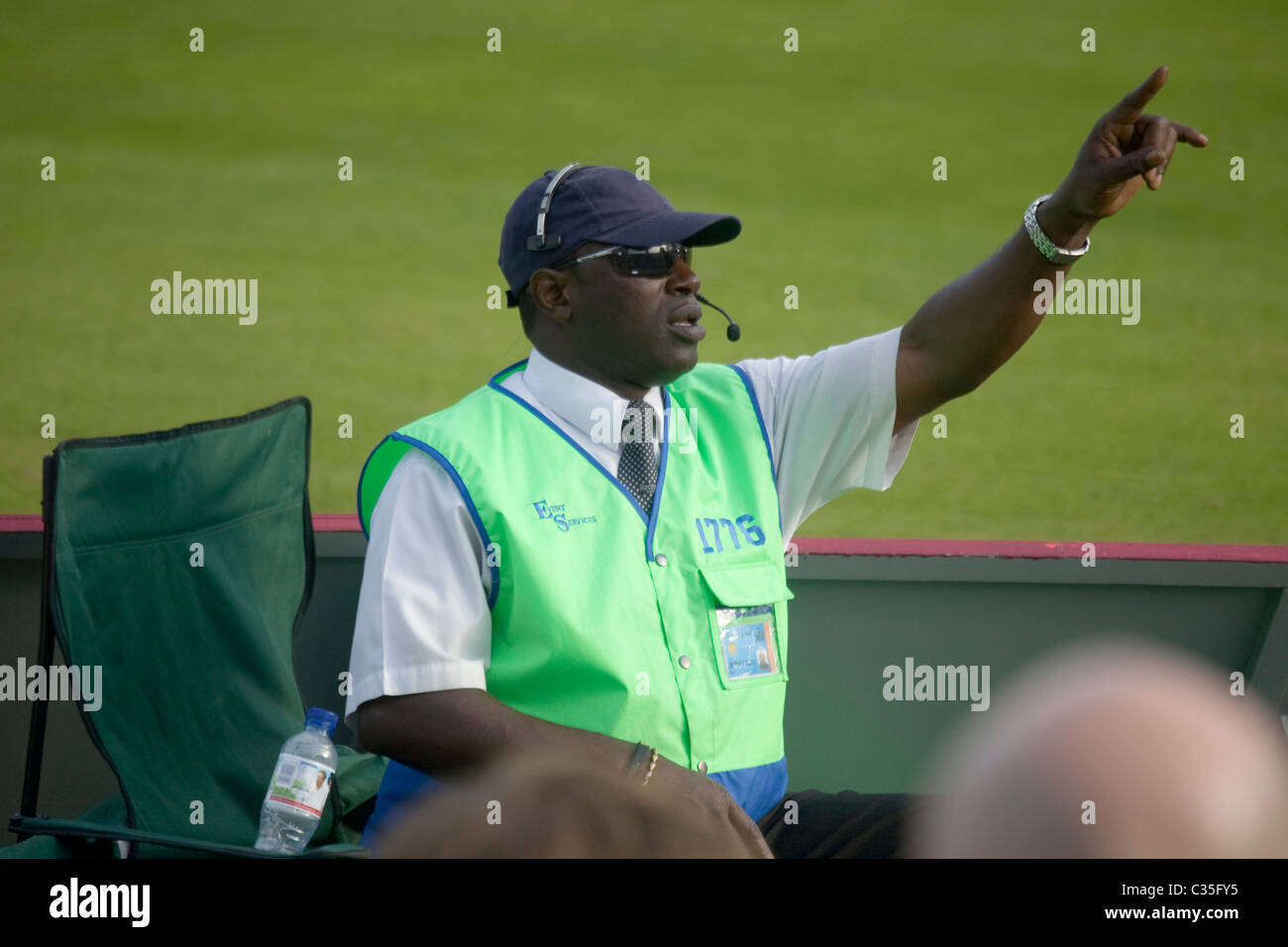 Security Official - Fourth Ashes Test Cricket Match Australia versus England held in Headingly England - Stock Image