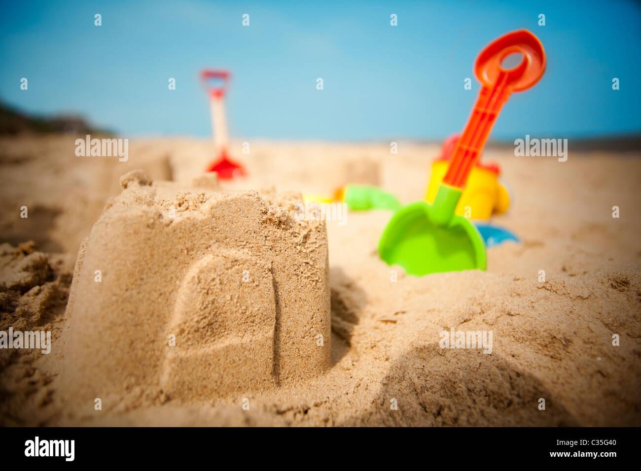 Sand castle on beach - Stock Image