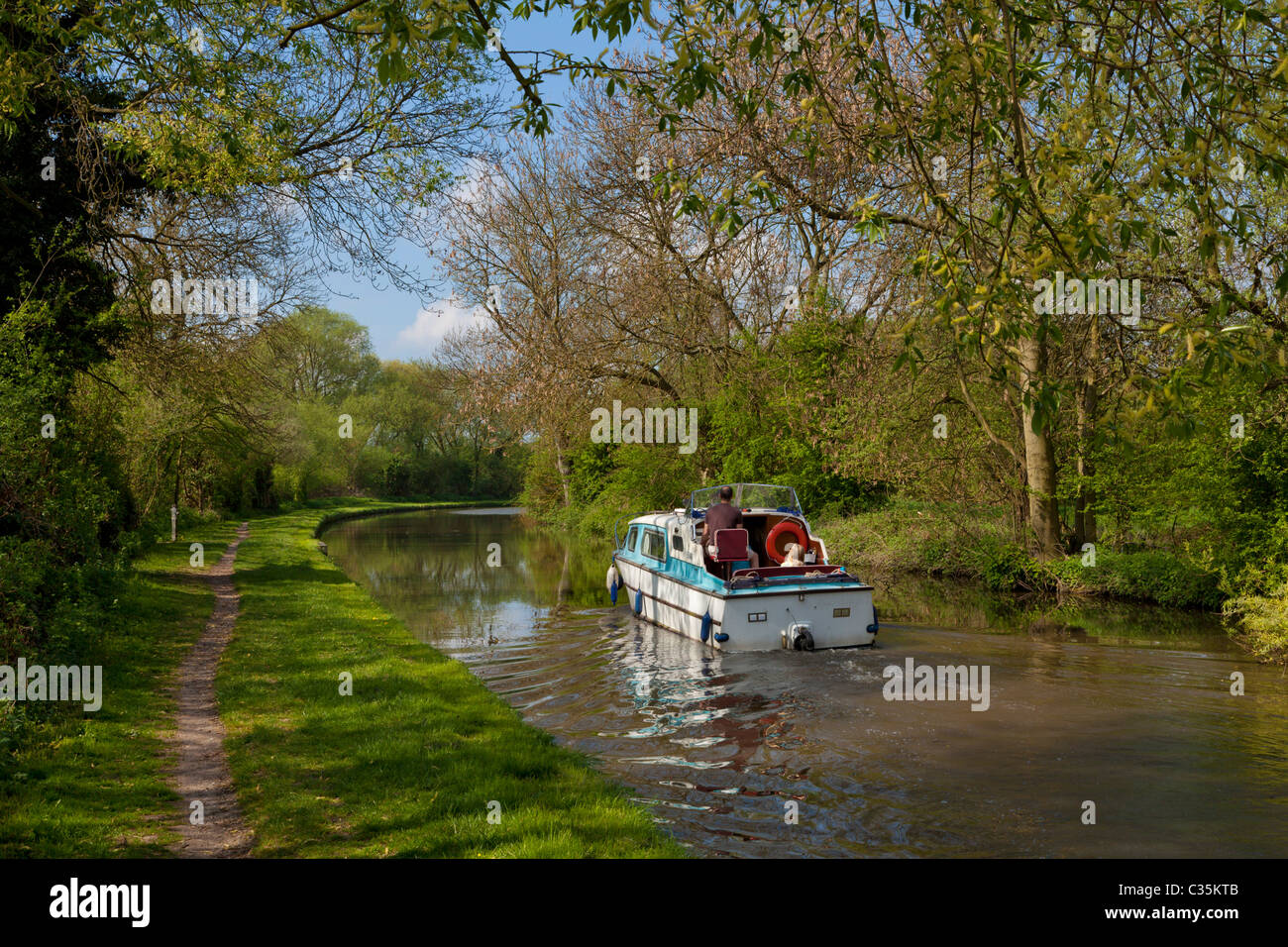 Small motor boat on the Trent and Mersey Canal near Aston on Trent Derbyshire England UK GB EU Europe - Stock Image