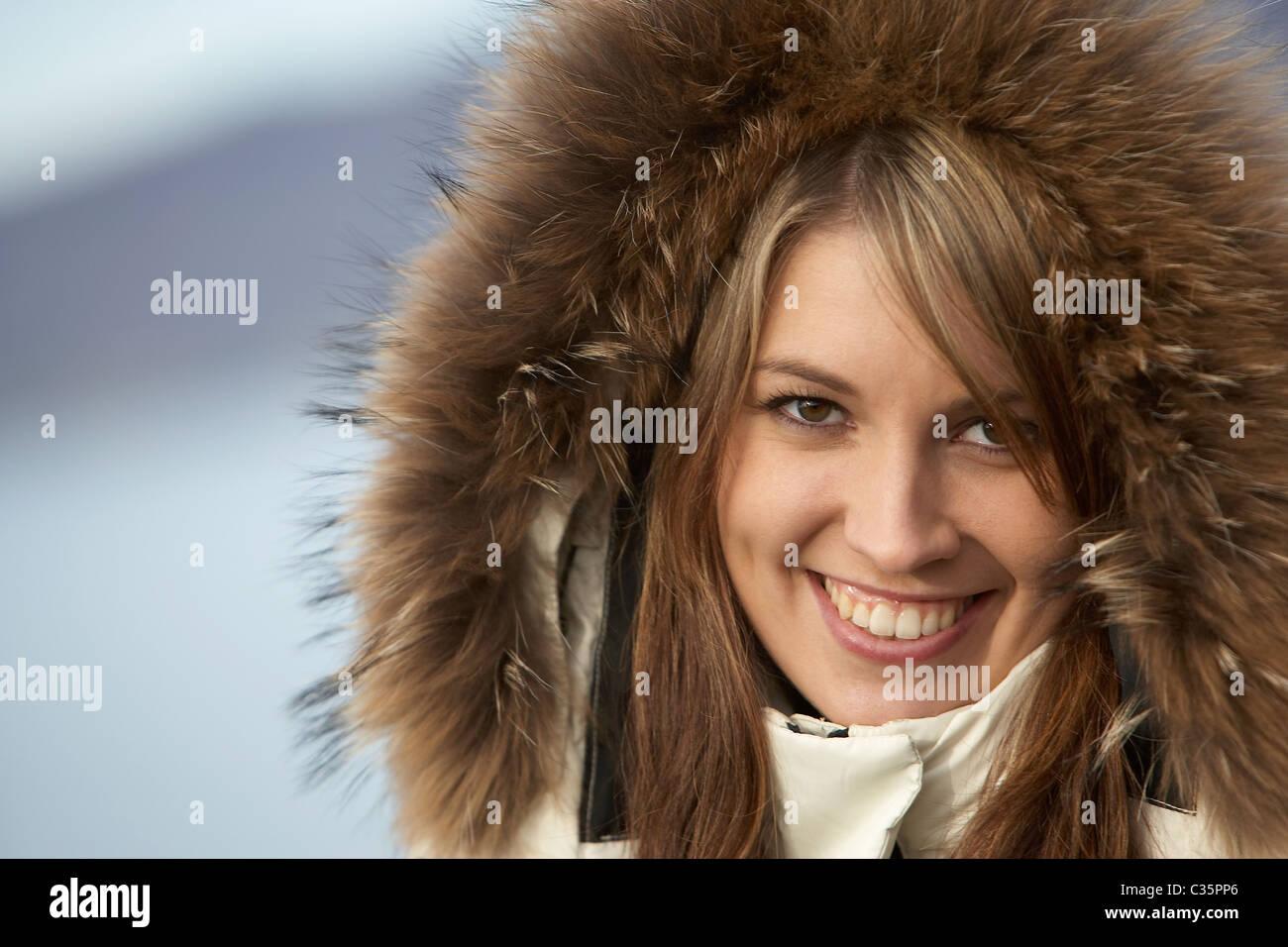 Female portrait, wearing fur hood - Stock Image