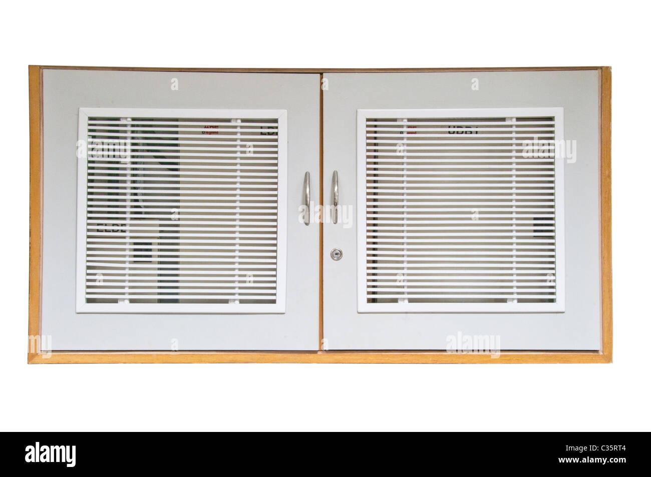 Closed shelves on white background - Stock Image