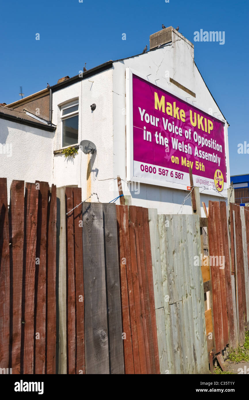 Advertising billboard on PRIMESIGHT side wall of house site 48 sheet poster advert for UKIP political party in Welsh - Stock Image