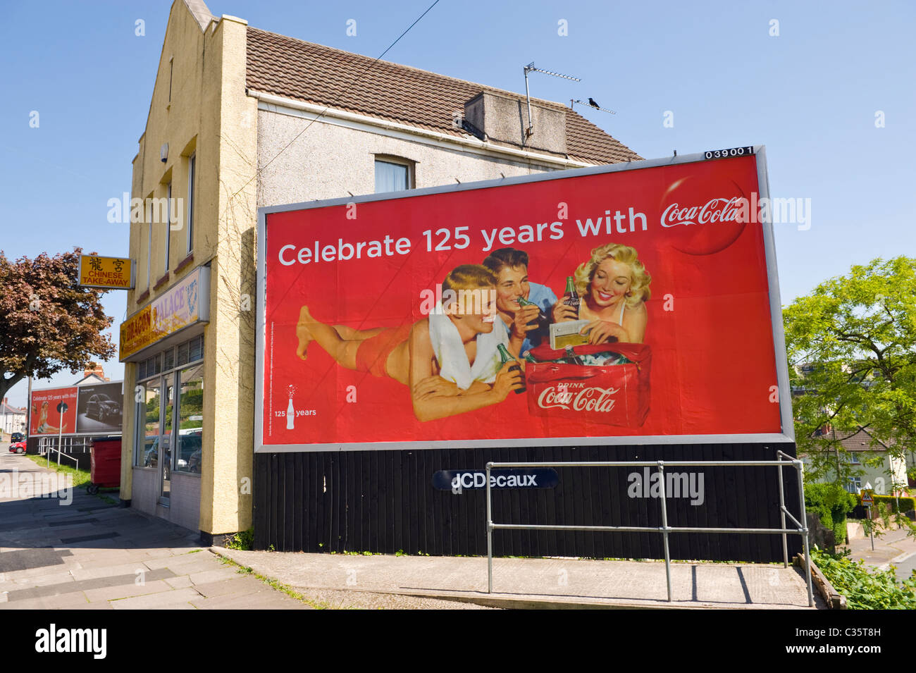 Advertising billboard on JCDecaux site advert celebrating 125 years of COCA COLA - Stock Image