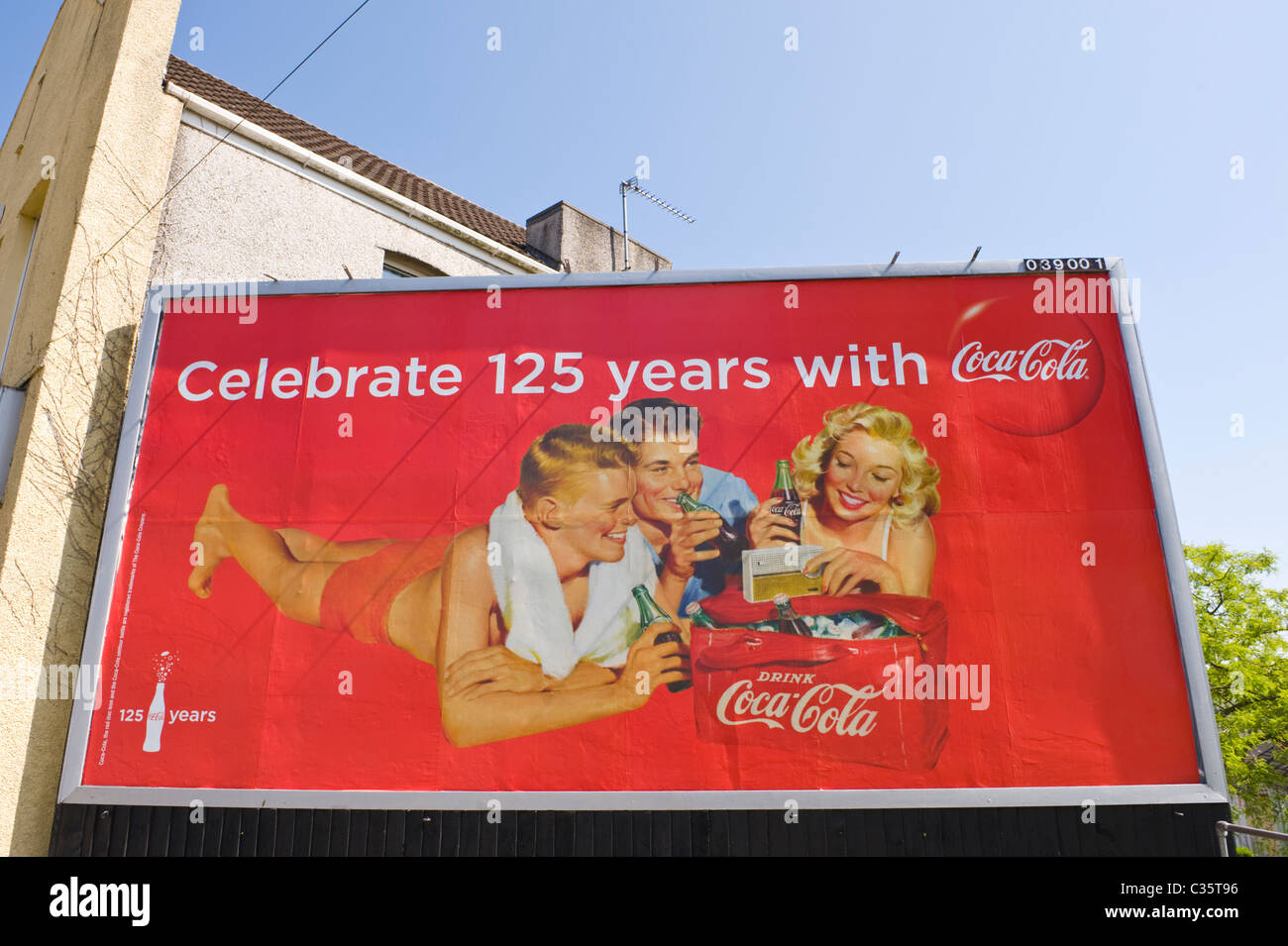 Advertising billboard on JCDecaux site 48 sheet poster advert celebrating 125 years of COCA COLA - Stock Image