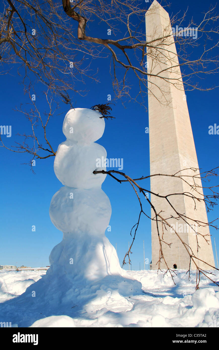 A snowman is on the National Mall near the Washington Monument after a near-record snowfall in the Washington DC - Stock Image