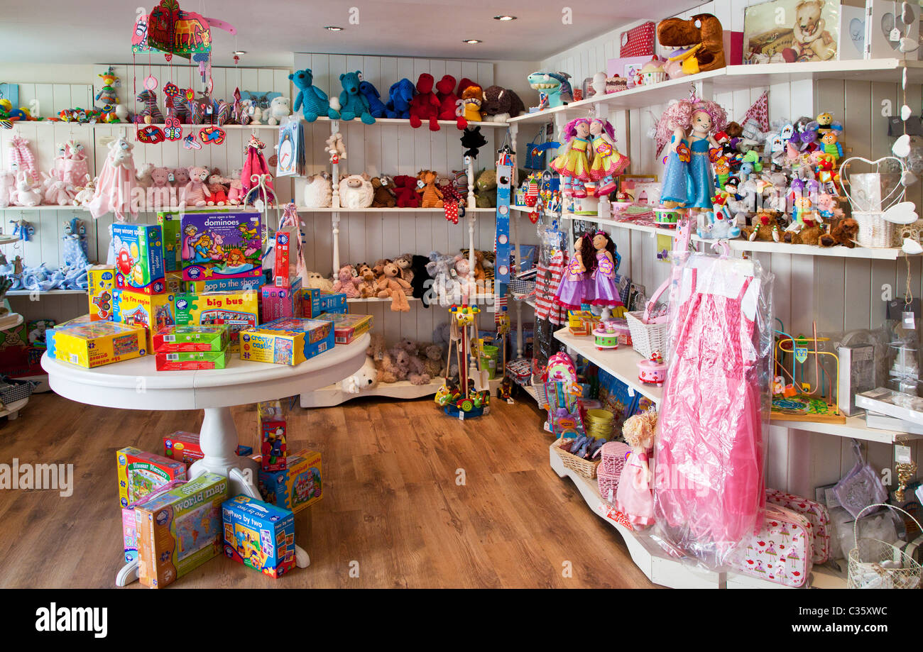 Interior of a boutique with babies and toddlers soft toys, games, and cuddlies - Stock Image
