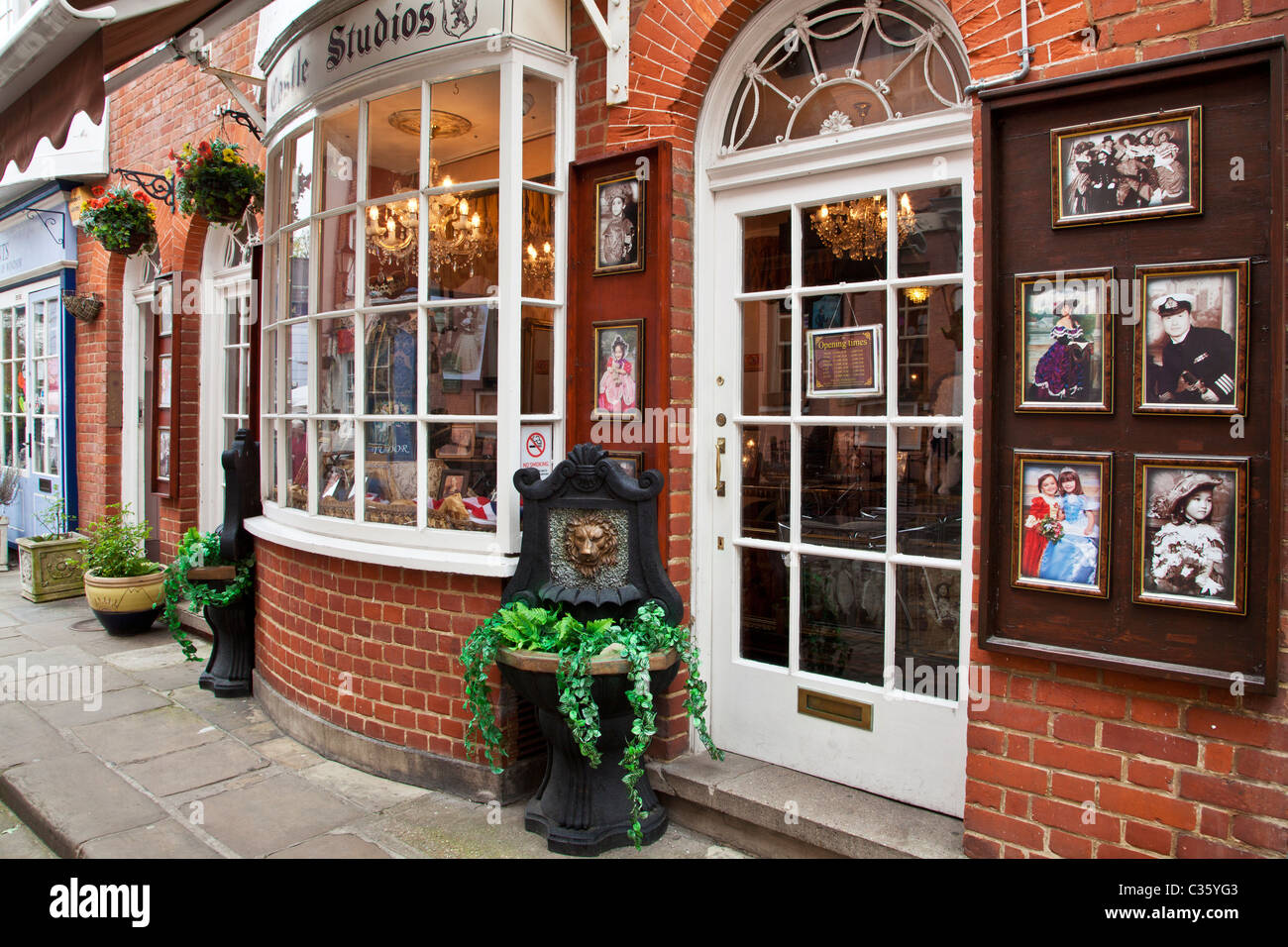 Pretty bay windowed Georgian shop front in Church Street, a small cobbled street in Windsor, Berkshire, England, - Stock Image