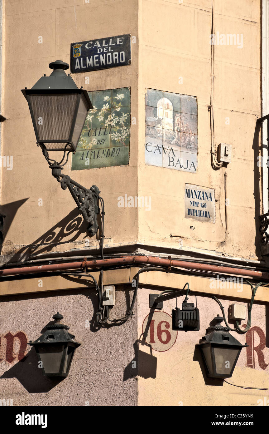 Old street lights and signs on the junction of Calle del Almendro and Cava Baja in the La Latina district of old - Stock Image